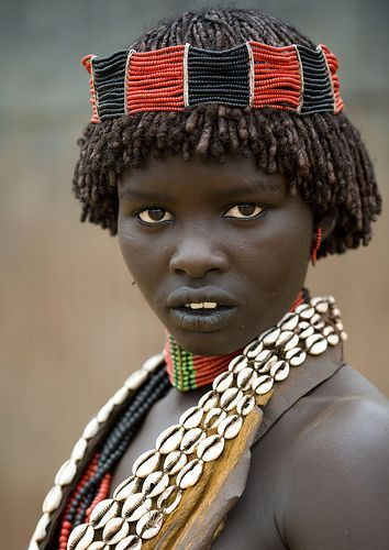 Adorned girl from Hamar tribe, Ethiopia.