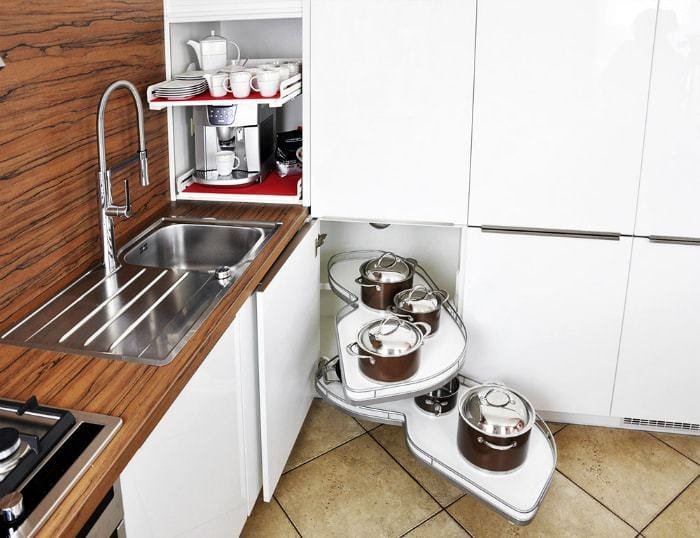 Kitchen cabinet with sliding shelves.