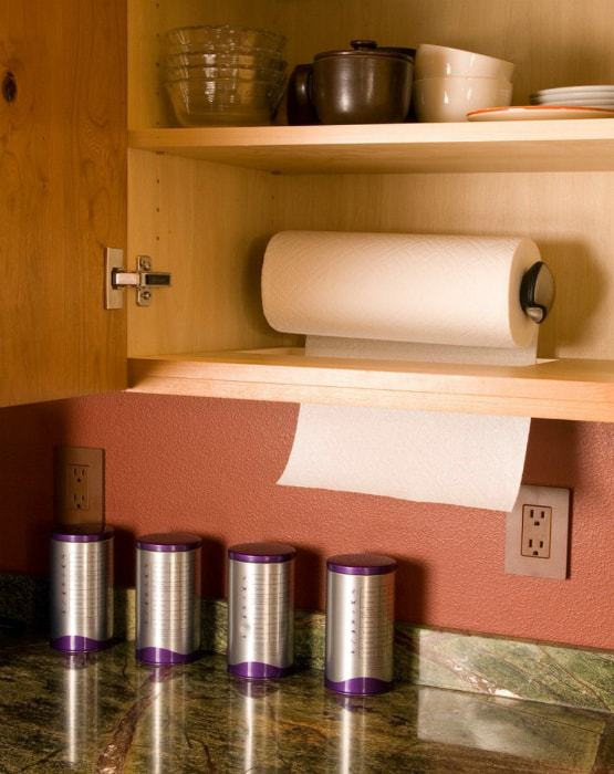 Hidden storage of a roll of paper towels.