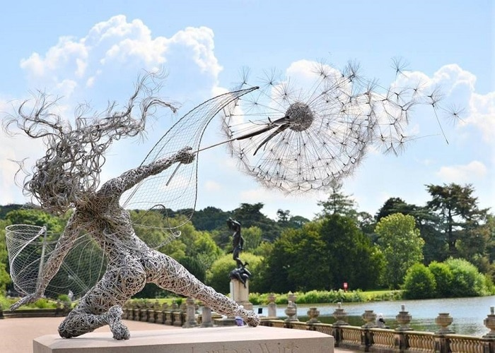 An elegant and dynamic sculpture made from numerous coils of wire.