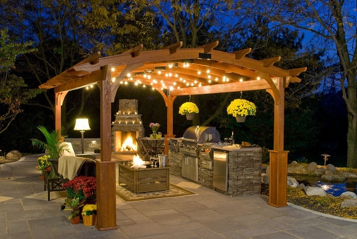 Arbor with a fully open kitchen and fireplace, made in the form of an arch.