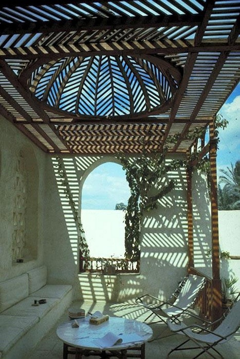 Simple openwork gazebo with incredible lines that create a wonderful atmosphere and filter light and air.