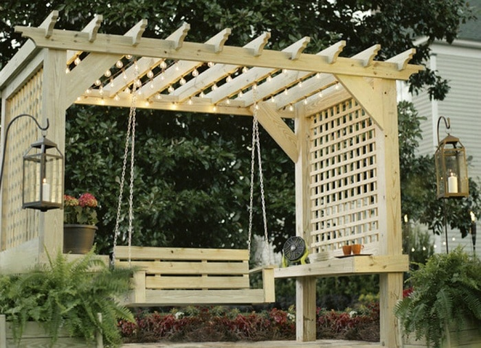 Wooden construction pergolas with swings and side bars that protect from prying eyes.