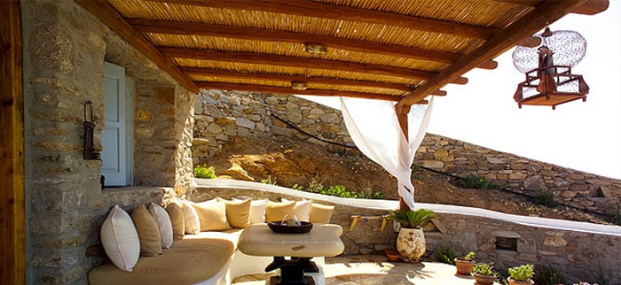 A beautiful Mediterranean pergola that creates shade with an excellent seating area.