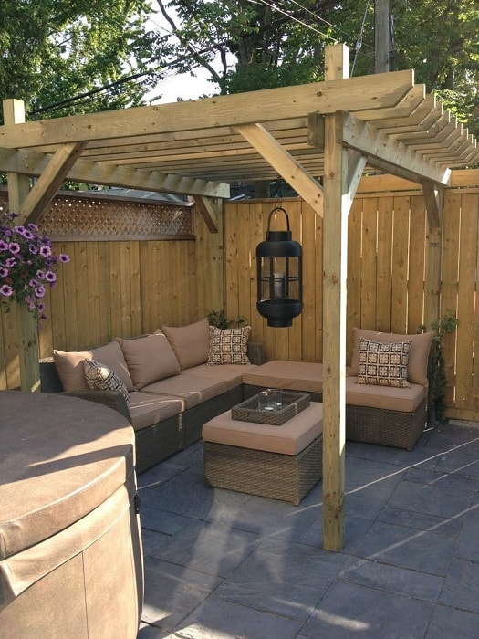 A simple corner pergola with an excellent L-shaped sofa, which can accommodate a decent company.