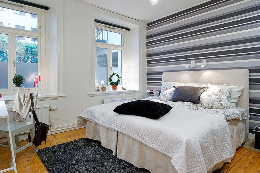 Bedroom in colors: black, gray, light gray, white. Bedroom in the style of the Scandinavian style.