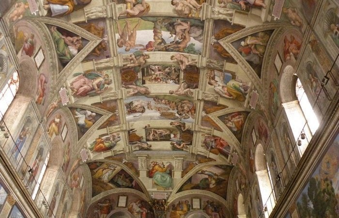 The ceiling of the Sistine Chapel, painted by Michelangelo.