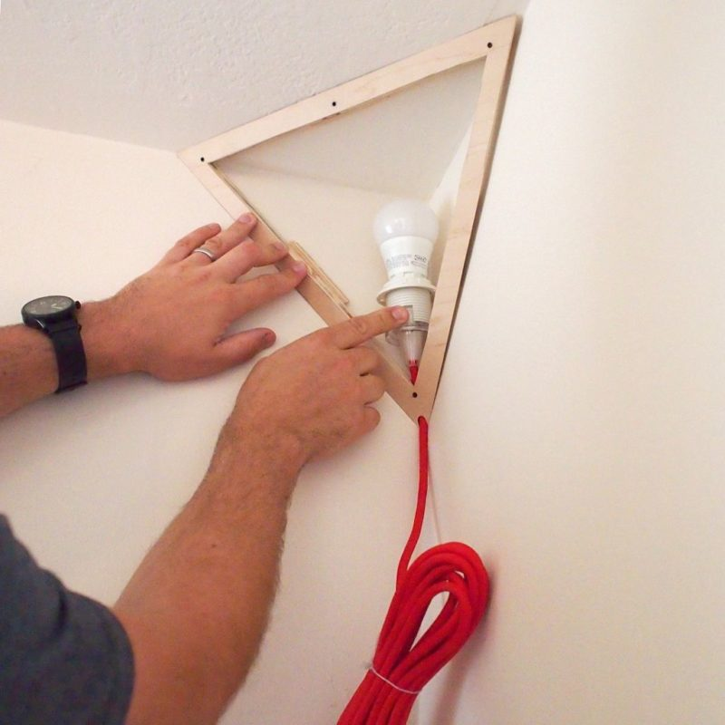 fixing the corner lamp to the wall